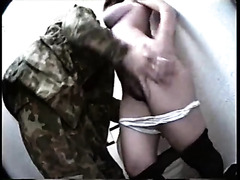Soldier fucks a busty hooker in cramped toilet