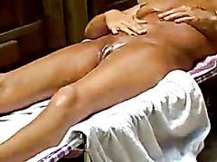 Tanned mature body coated in oil