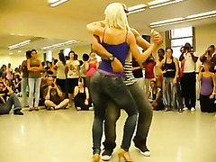 Erotic dance with sexy couple in front of a class