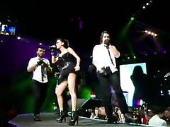 Sexy Italian popstar in concert wears a tiny little dress