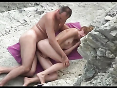 Skinny girl passionately fucked by daddy on a towel