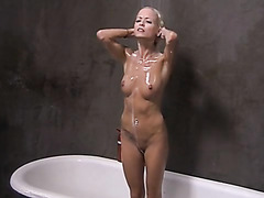 Blonde goddess on reality show takes naked shower