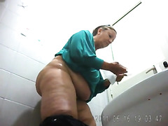 Fat granny in tight pants urinating in the clinic restroom