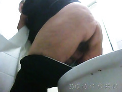 Chubby granny pisses in the clinic WC