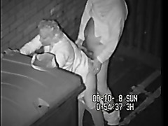 Mature couple fucks behind a dumpster on security camera