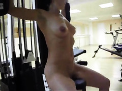 Sexy brunette babe works out naked in the gym