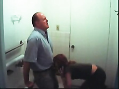 Young secretary sucks off a boss's cock in the office toilet
