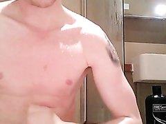 Hot guy jerks off in shower