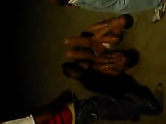 2 girls getting pissed on by friends late at night on a beach