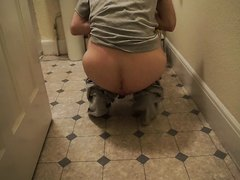 Taking a shit on the bathroom floor