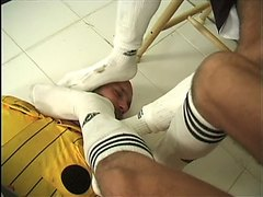 Soccer feet and socks sniffing and licking