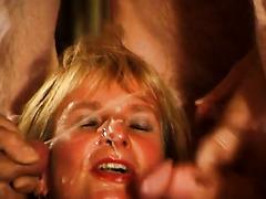 Mature slut in a sex club covered in cum