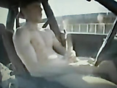 Hottie jerks off as he drives his car