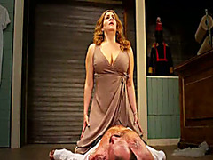 Bizarre opera scene with lady pissing on a man
