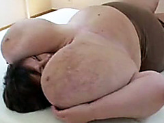 Mature BBW plays with her gigantic breasts