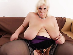 Solo blonde BBW teases in black stockings