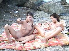 Beautiful bikini girls piss and fist on the rocks