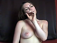 Naked brunette girl eats her boogers