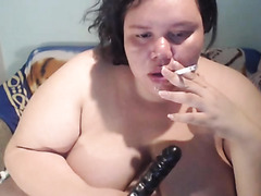 BBW smokes and gags on her dildo