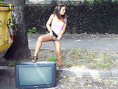 Cute girl pisses on a public street