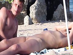 Naked couple on public beach