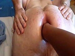Fist fucking his lubed up bottom anus