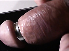 Metal ring squeezes his erect penis tight