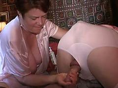 Wife jerks off her crossdressing sissy husband