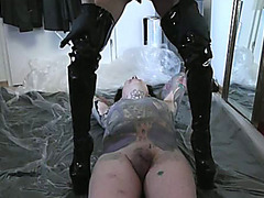 Mistress defecates on her slave and rubs it in