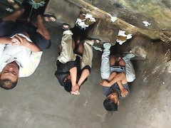 Group of Chinese guys at open public squat toilets