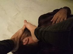Russian young guy humiliates foot slave.