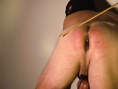 Dildoguy, caning post enema