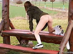 Girl pissing outdoor