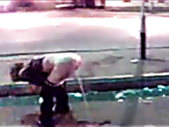 Drunken girl pisses in public and people film it