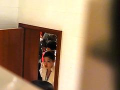 Asian girls peeing in a public bathroom