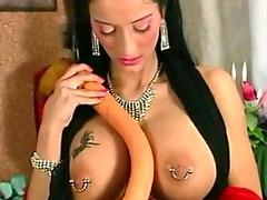 Brunette masturbates her heavily pierced pussy