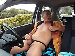Horny guy jerking off in his parked car