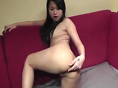 Hot Asian takes a coke can in the butt