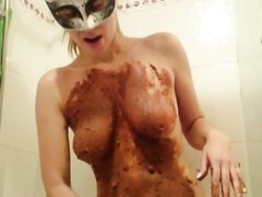 Very hot blonde woman swallows her own shit in the bathtub.