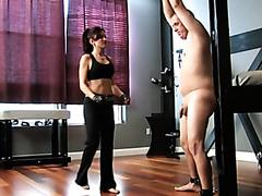 Fighter mistress molesting her spineless slave