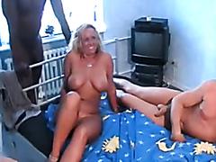 Busty blonde cougar enjoys a nice gangbang