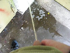 Pissing in a good friends pee puddle behind abandoned house