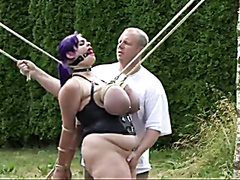 Fat girlfriend is all tied up in the yard