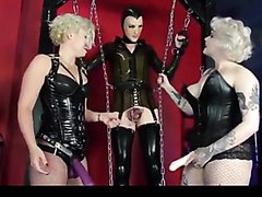 Slave sissy in latex gets fucked by two mistresses