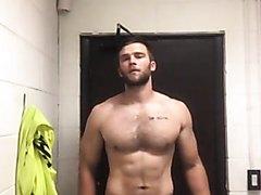 Sexy guy undressing a bit
