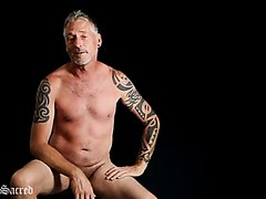 Tattoed man naked talking 1