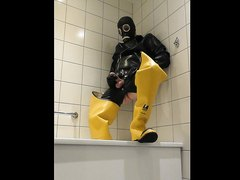 Piss and cum in rubber, waders and gasmask