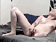 A blond amputee toying