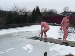 Mature men in the ice swimming pool