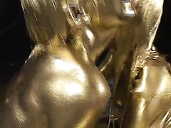 Japanese girls paint each other gold and silver. Odd, but fucking awesome.